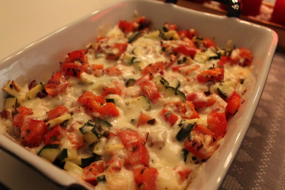 Fläskfilé under ost- och grönsakstäcke